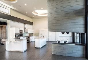 Contemporary Kitchen with Kitchen island, Corian counters, European Cabinets, Skylight, Breakfast nook, Undermount sink