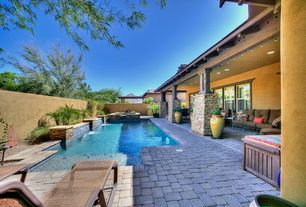 Traditional Swimming Pool with Pathway, double-hung window, exterior stone floors, Fountain, Fence, Pool with hot tub