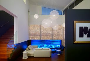 Living Room with Hardwood floors, specialty window, High ceiling, Sunken living room, Pendant light