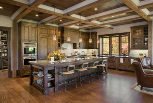 Craftsman Kitchen with Wood counters, Farmhouse sink, electric cooktop, Calacatta Gold 1x3 Herringbone Mosaic Tile Honed