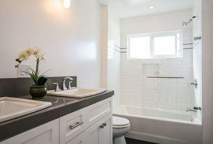 Traditional Master Bathroom with frameless showerdoor, Double sink, Shower, slate floors, Standard height, partial backsplash