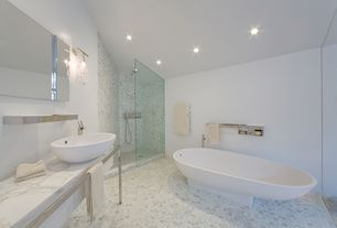 Contemporary Master Bathroom with Freestanding, frameless showerdoor, Simple marble counters, ceramic tile floors