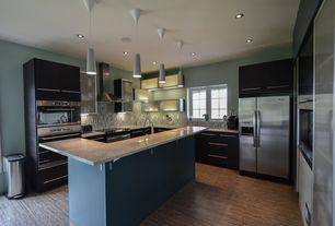 Contemporary Kitchen with Ceramic Tile, Corian counters, Silestone-Quartz Countertop in Lagoon, Flush, U-shaped