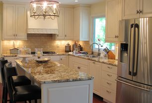 Traditional Kitchen with Stone Tile, Chandelier, can lights, full backsplash, Onyx counters, Custom hood, Flat panel cabinets