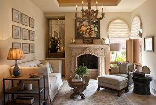 Mediterranean Living Room with travertine floors, Arched window, Built-in bookshelf, Chandelier, stone fireplace