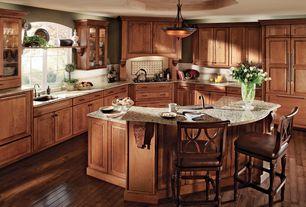Craftsman Kitchen with Custom hood, Breakfast bar, Standard height, Built In Panel Ready Refrigerator, Framed Partial Panel