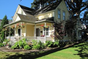 Traditional Exterior of Home with Clapboard siding, Pathway, French doors, Wrap around porch
