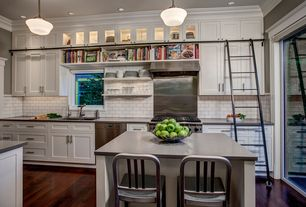 Craftsman Kitchen with Crown molding, Bookshelf ladder, Indoor outdoor brushed aluminum jailhouse chair, Glass panel