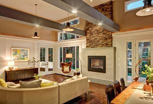 Traditional Great Room with Laminate floors, Transom window, French doors, Pendant light, High ceiling, Exposed beam