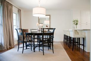 Traditional Dining Room with Hardwood floors, Pendant light, Built-in bookshelf, Crown molding