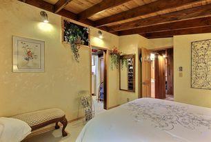 Mediterranean Guest Bedroom with Exposed beam, Standard height, Carpet, Wall sconce, six panel door
