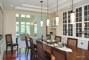 Traditional Dining Room with Wainscotting, Laminate floors, Built-in bookshelf, Pendant light