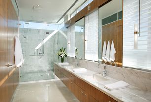 Contemporary Master Bathroom with frameless showerdoor, Complex marble counters, Wall sconce, European Cabinets, Flush
