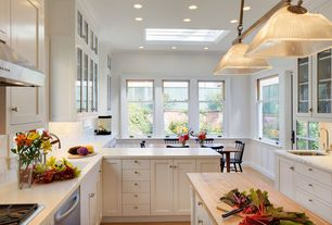 room with single dishwasher, Corian counters, Prep station, Glass front cabinets, Recessed lighting, gas cooktop, Skylight