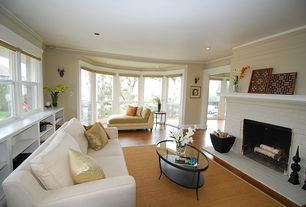 Contemporary Living Room with can lights, brick fireplace, double-hung window, Laminate floors, Built-in bookshelf, Fireplace