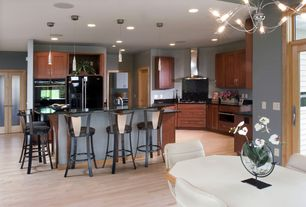Contemporary Kitchen with Breakfast bar, Flat panel cabinets, Built In Refrigerator, Pendant light, Standard height, Flush