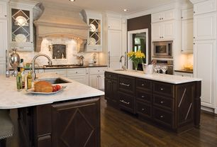 Traditional Kitchen with Stone Tile, L-shaped, Glass panel, built-in microwave, can lights, Flat panel cabinets, Custom hood