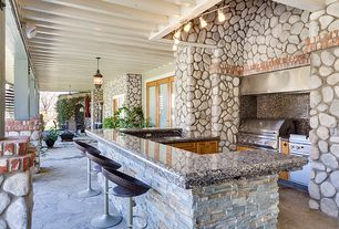 Eclectic Porch with Outdoor kitchen, Wrap around porch, exterior stone floors, French doors