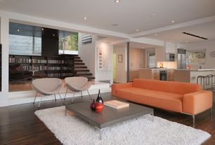 Contemporary Great Room with Built-in bookshelf, Hardwood floors, Sunken living room, Exposed beam, French doors, Columns