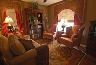 Traditional Living Room with Book Shelves, Hardwood floors, Ceiling fan, Standard height
