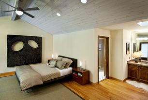 Contemporary Master Bedroom with Exposed beam, Skylight, Hardwood floors, High ceiling, Crown molding, Ceiling fan