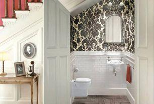 Traditional Powder Room with herringbone tile floors, White subway tile 3x6 glossy, Graham Brown Majestic Black / White