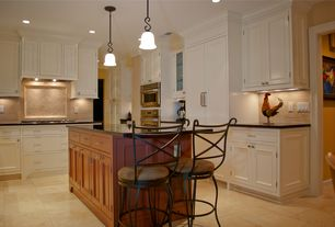 Traditional Kitchen with Kitchen island, Inset cabinets, Slate counters, MS International  Durango Antique Travertine Tile