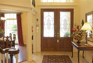 Traditional Entryway with Transom window, Columns, French doors, sandstone tile floors, High ceiling