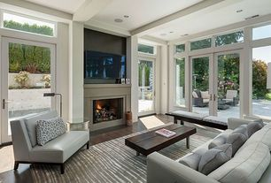 Contemporary Living Room with Standard height, Hardwood floors, picture window, Fireplace, Transom window, can lights