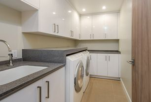 Traditional Laundry Room with limestone floors, Undermount sink, Built-in bookshelf