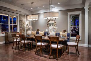 Contemporary Dining Room with Crown molding, flush light, Uttermost gotham sunburst wall mirror, Wall sconce, Hardwood floors