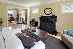 Traditional Living Room with Crown molding, Paint 1, Hardwood floors, Antique leaded windows, Fireplace, picture window