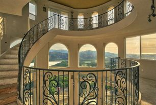 Mediterranean Staircase with Arched window, High ceiling, Concrete floors, curved staircase