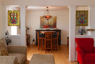 Craftsman Dining Room with Columns, specialty door, Laminate floors, flush light