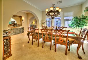 Traditional Dining Room with sandstone tile floors, High ceiling, French doors, Chandelier, Crown molding