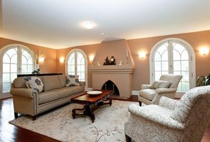 Traditional Living Room with French doors, flush light, Wall sconce, Hardwood floors, Cement fireplace