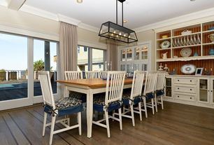Country Dining Room with Chandelier, Box ceiling, Casement, Crown molding, Built-in bookshelf, sliding glass door, can lights