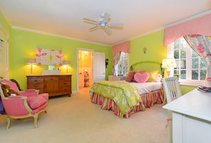 Traditional Kids Bedroom with specialty door, Crown molding, Carpet, Ceiling fan