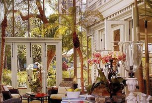 Tropical Living Room with Golden pheasant floor tile vintage catalog, High ceiling, French doors, Open space livingroom