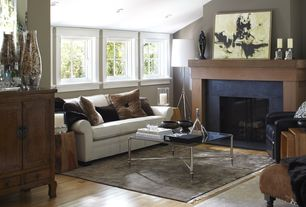 Contemporary Living Room with Cement fireplace, Laminate floors, Standard height, Fireplace, can lights, Casement