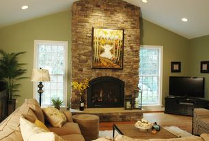 Traditional Living Room with can lights, stone fireplace, Hardwood floors, double-hung window, Fireplace, Standard height