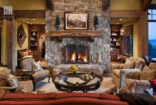Rustic Living Room with can lights, Exposed beam, Commodore maple wood fireplace mantel shelf, stone fireplace, Fireplace