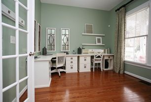 Traditional Home Office with Hardwood floors, Built-in bookshelf, French doors