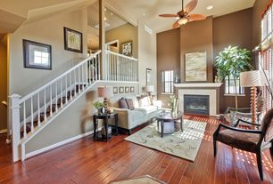 Traditional Living Room with can lights, picture window, Fireplace, Ceiling fan, High ceiling, Hardwood floors