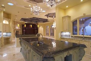 Traditional Kitchen with Framed Partial Panel, U-shaped, Undermount sink, limestone tile floors, Simple granite counters