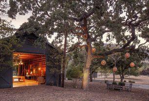 Rustic Landscape/Yard with Hgtv home rattan hanging solar lantern