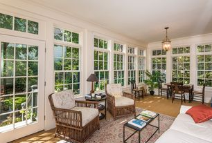 Traditional Porch with Lloyd flanders grand traverse all-weather wicker lounge chair, Carpet, Crown molding, Sun porch
