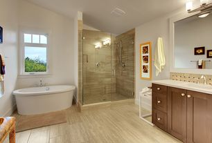 Contemporary Master Bathroom with Handheld showerhead, Stone Tile, stone tile floors, Rain shower, picture window, Shower