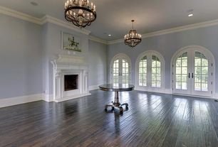 Traditional Great Room with can lights, Hardwood floors, Chandelier, Standard height, Fireplace, Cement fireplace