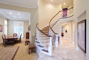 Traditional Staircase with Crown molding, Hardwood floors, curved staircase, High ceiling, can lights